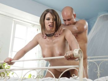 Hot brunette Monalee rubbed with oil on breasts
